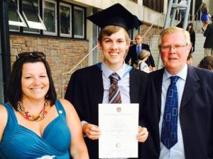 My mum, me and my dad, just after the ceremony, with my sticky foot (our way of saying 'certificate', just so you know).