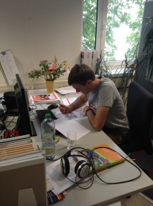 We took lots of photos to send to our lecturer back in Exeter. Here's one of me working hard at my desk...